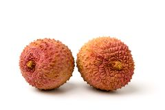 Two lychee fruit on a white Royalty Free Stock Photo