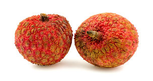 Two lychee fruits isolated on white Stock Image