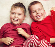 Two lying and laughing boys Royalty Free Stock Images
