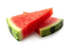 Two lying triangles of seedless watermelon isolated on white. With rind royalty free stock images