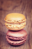Two macaroons on vintage wooden background Royalty Free Stock Image