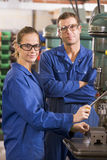 Two machinists working on machine Stock Image