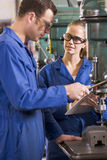 Two machinists working on machine Stock Images