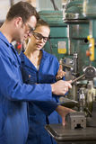 Two machinists working on machine Royalty Free Stock Photos