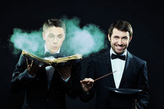 Two magicians. Portrait of two magicians with magic book and top hat ready to do their tricks Stock Images