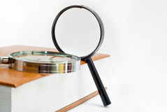 Two magnifier and book Stock Photo
