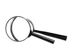 Two magnifiers isolated. Two magnifiers on white background Stock Images