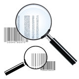 Two magnifying glasses over bar codes Royalty Free Stock Image