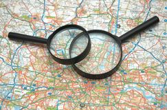 Two magnifying glasses over th. Two magnifying glasses over  the map of London Royalty Free Stock Photos