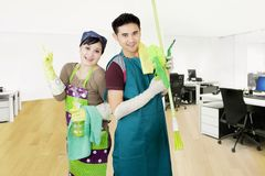 Two maids standing in the office Stock Photo