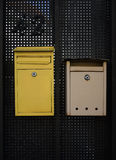 Two mail boxes. On black wall stock images