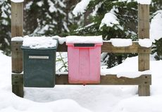 Two mailboxes in a wintery forest with blank empty signs royalty free stock photos