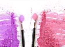 Two make up blush on crushed make up powder.  Stock Photos