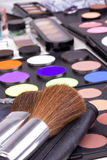 Two make-up brushes on eyeshadows palettes. Closed-up Stock Photos