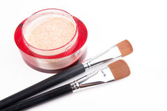 Two make-up brushes and red box with powder Stock Image
