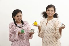 Malay women with pelita Royalty Free Stock Photo