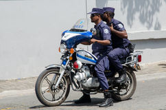 Two maldivian policemen riding on motorbike at street. Male.Maldives Royalty Free Stock Image