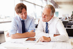 Two male architects working together at a desk in an office Royalty Free Stock Photography