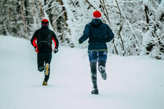 Two male athlete running on winter alley in Park Stock Photography