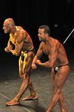 Two male bodybuilders showing their most muscular pose Royalty Free Stock Photos