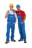 Two male builders. Stood together stock photography