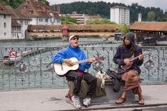 Two male buskers singing and playing guitars. Lucerne, Switzerland June 10 2013 - Two men singing and playing guitars to entertain tourists and locals Stock Image