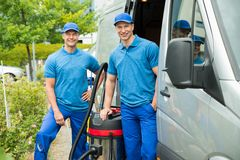 Two Male Cleaners With Vacuum Cleaner Stock Photography