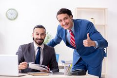 Two male colleagues in the office royalty free stock images