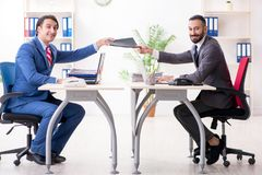 The two male colleagues in the office royalty free stock images