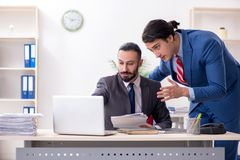 Two male colleagues in the office stock image