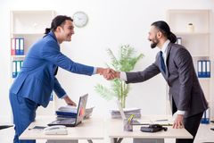 Two male colleagues in the office stock photography