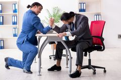 Two male colleagues in the office stock images