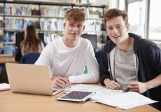 Two Male College Students Collaborating On Project In Library Royalty Free Stock Photo