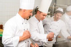 Two male cook work in professional kitchen Royalty Free Stock Image