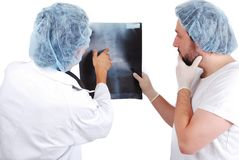 Two male doctors looking at scan image Stock Image