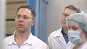 Two male doctors and a nurse managing surgery. Close up shot. Professional shot in 4K resolution. 097. You can use it e.g. in your commercial video, business Royalty Free Stock Photography
