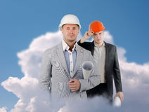 Two Male Engineers on Clouds Looking at Camera Stock Image
