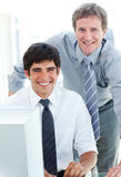 Two Male Executives Working At A Computer Stock Photo