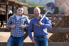Two male farmers at farmyard Stock Image