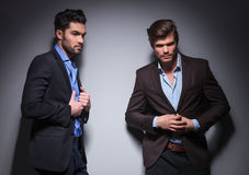 Two male fashion models posing in studio stock photo