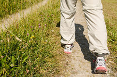 Two male feet are hiking on path Royalty Free Stock Image