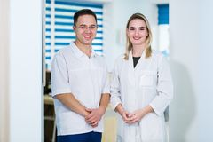 Two Male and Female Doctors or Nurses Standing Inside Hospital Building. Royalty Free Stock Photo