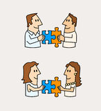 Two male and female matching puzzle pieces Royalty Free Stock Photography