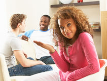 Two Male Friends Chatting Together With Female. Two Male Friends Chatting Together With Bored Looking Female Partner At Home royalty free stock image