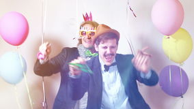 Two male friends having fun with props stock footage