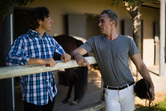 Two male friends interacting with each other in the ranch Stock Images