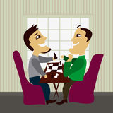 Two male friends playing chess. At quit interior Stock Images