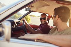 Two Male Friends Relaxing In Car During Road Trip Royalty Free Stock Photo