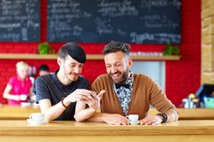 Two male friends sitting in cafe Stock Photos