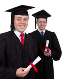 Two male graduates with scrolls, isolated on white Stock Photo